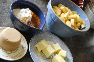 All the ingredients you'll need: flour, spices, brown sugar, apples, and butter