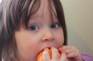 Baking with fresh, juicy peaches is fabulous, but this little girl has found the best way: right out of hand!