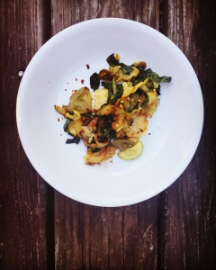 Sauteed squash over pan fried grit cakes